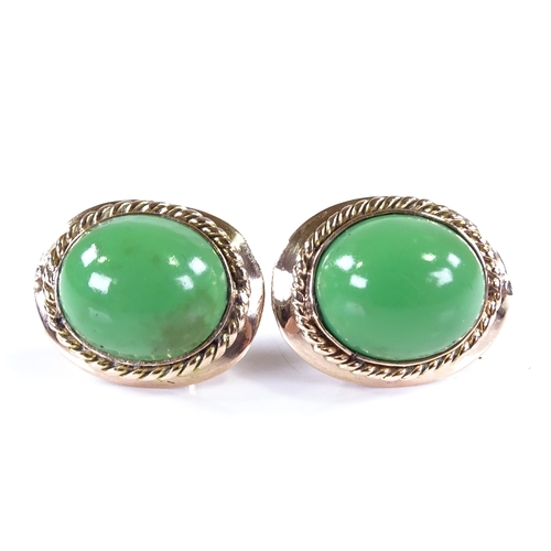 813 - A pair of unmarked rose gold cabochon green stone earrings, earring height 16.6mm, 4.7g...