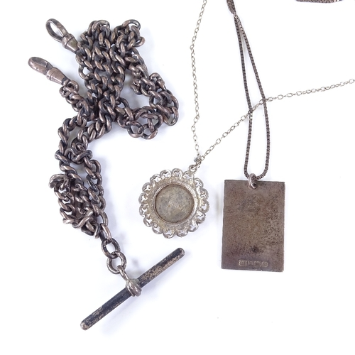 829 - An early 20th century silver curb link Albert chain with T-bar and 2 dog clips, and 2 other pendant ...