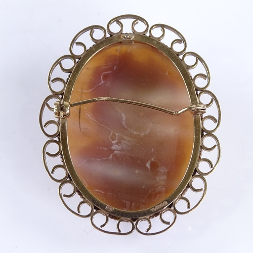 853 - A relief carved shell cameo panel brooch, depicting female bust, in 9ct gold frame, overall height 4...