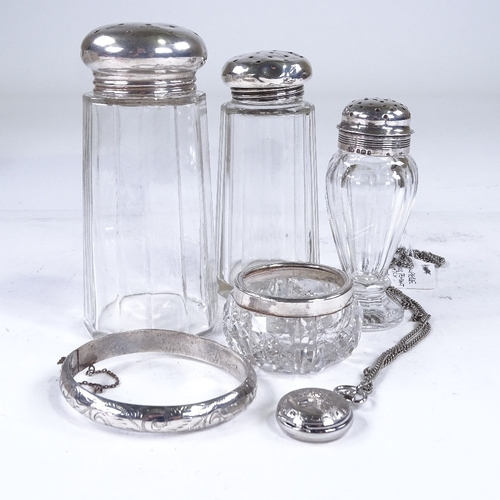 865 - Various silver items, including glass dressing table jars, hinged bangles, fob watch etc...