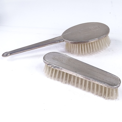 868 - 3 silver-backed dressing table items, including hand mirror, brush and clothes brush, hand mirror le...