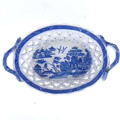 200A - A 19th century blue and white transfer printed Creamware basket, with pierced lattice sides, length ...
