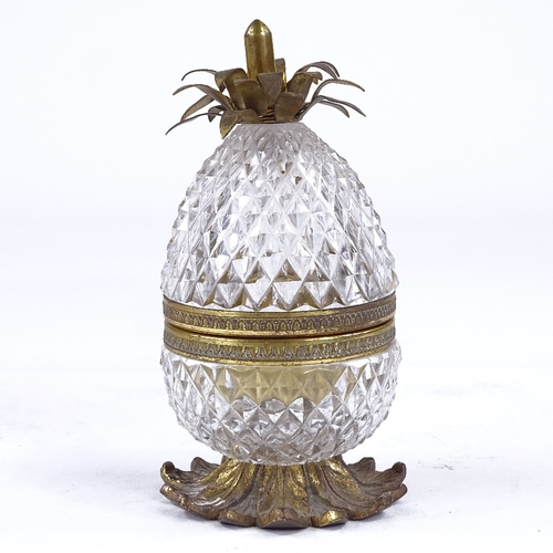 270A - A late 1930s Cristal et Bronze cut-glass and gilt-metal novelty desk inkwell, modelled as a pineappl...