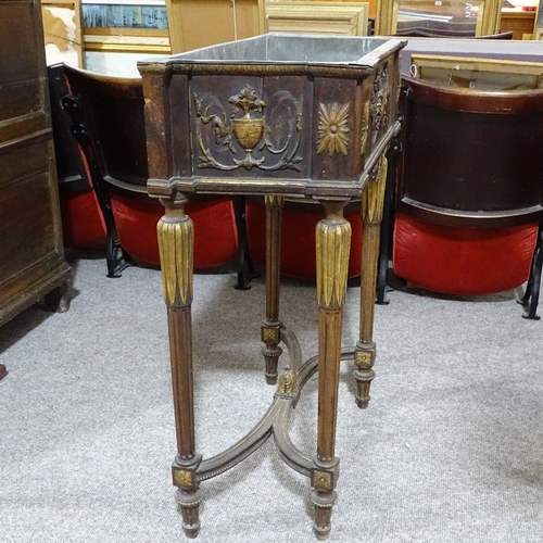 324 - A 19th century French parcel gilt and walnut jardiniere, with zinc liner, and relief moulded decorat...