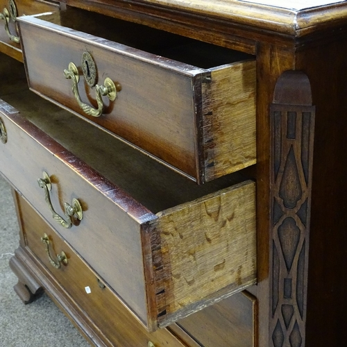 346 - A George III mahogany chest of 3 long and 2 short drawers, with blind fret carved corners, and ogee ...