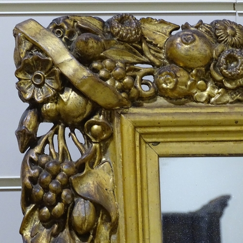 393 - A large Victorian gilt-gesso framed wall mirror, with fruit decorated surround, overall dimensions 9...