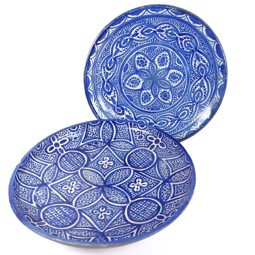 12 - 2 Moroccan blue and white pottery chargers, largest diameter 38.5cm, 1 A/F, (2)...
