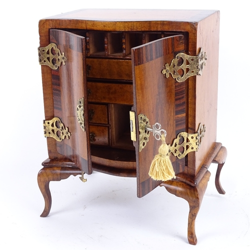 13 - A miniature satinwood rosewood and walnut apprentice piece serpentine-front cabinet on stand, pierce...