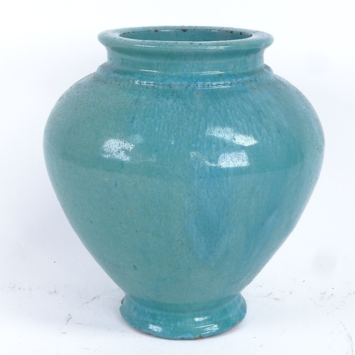 14 - A Chinese turquoise glaze pottery baluster vase, height 20cm...