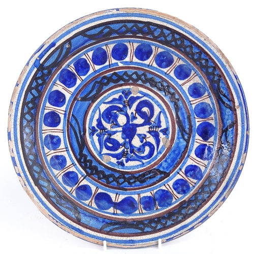 20 - A 19th century European pottery charger, blue and white glaze decoration, diameter 32cm...