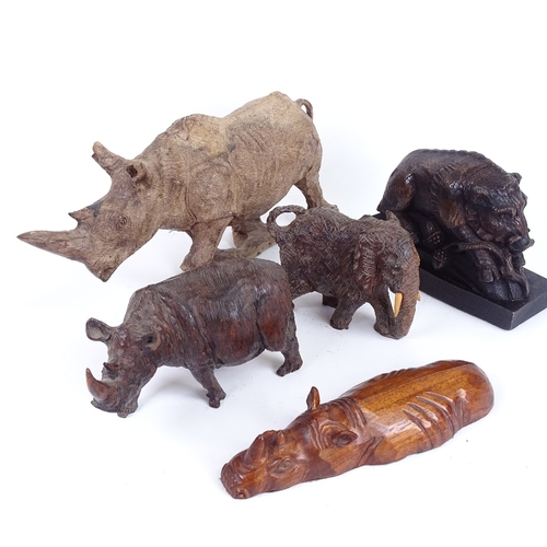 24 - A group of carved hardwood animals, including rhino and boar, largest length 32cm (5)...