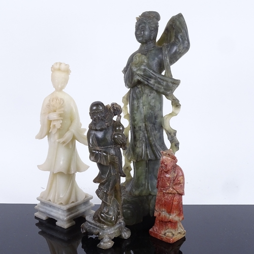 31 - A group of Chinese hardstone carvings, depicting Guanyin and sages, largest height 30cm (4)...