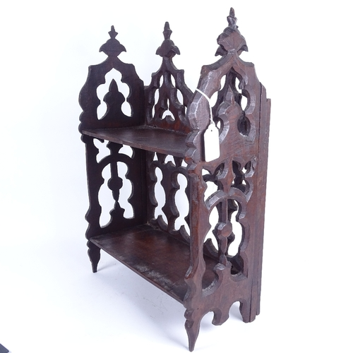 34 - A 19th century carved and pierced mahogany Gothic bookshelf, width 33cm, height 48cm...
