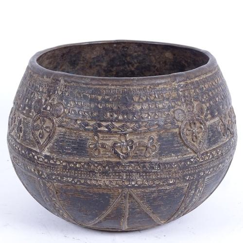 40 - A Middle Eastern? bronze bowl, allover Arabesque decoration, diameter 16cm...