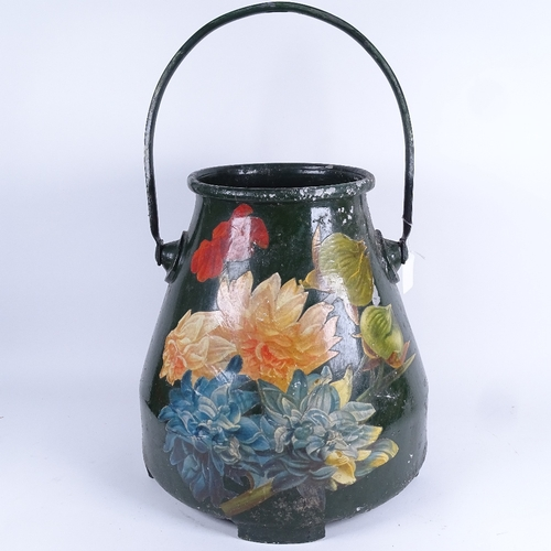44 - A large Toleware aluminium bucket, printed floral decoration with swing handle, height 36cm...