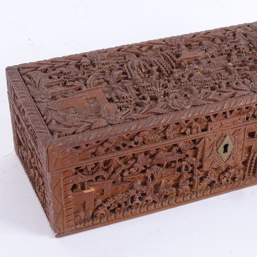 51 - A 19th century Chinese carved sandalwood glove box, relief carved courtyard scenes, length 25cm (1 s...