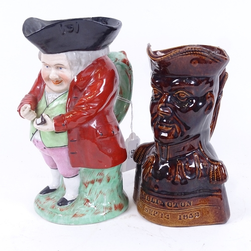 59 - A Chelsea Pottery Toby jug, and a treacle glazed Duke of Wellington character jug, height 18cm (2)...