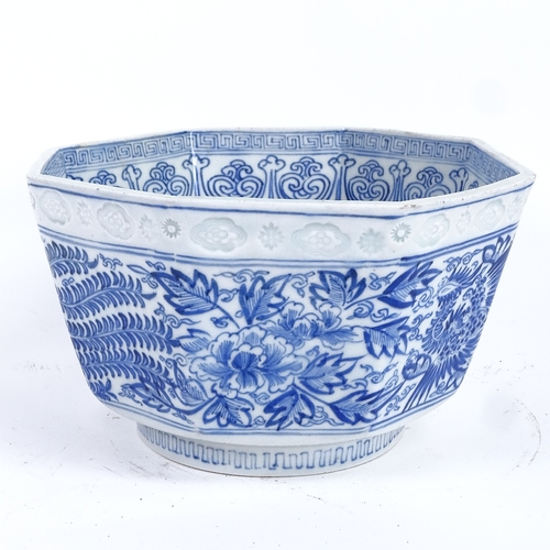 8 - A Chinese blue and white octagonal phoenix jardiniere, seal mark on base with impressed decoration, ...