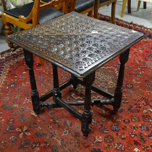 2045 - An Antique oak triangular single drop leaf table, with allover chip carved decoration, W82cm, H69cm...