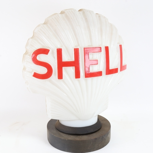 22 - A Vintage Shell Petrol illuminating opaque white glass advertising petrol pump globe lamp, on turned...