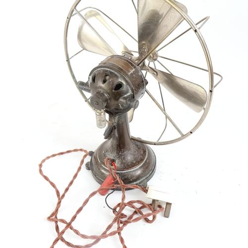 26 - An early 20th century Austrian Monso cast-iron electric table ventilator van, with aluminium blade c...