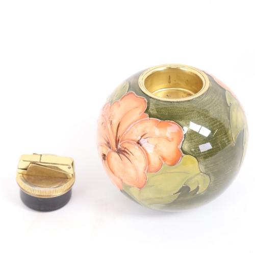 30 - A Moorcroft Hibiscus pattern table lighter, diameter 10.5cm