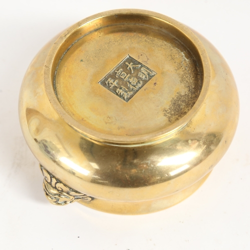 42 - A Chinese bronze censer, 6 character Xuantong mark, with lion handles, rim diameter 11.5cm, height 6...