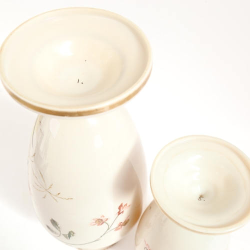 47 - A graduated pair of Victorian milk glass vases, hand painted and gilded bird and floral decoration, ...
