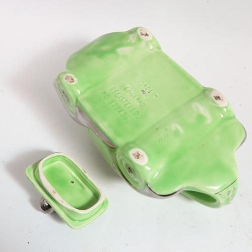 54 - An Art Deco Sadler racing car teapot, circa 1930s, green glaze with silvered detailing, registered n...