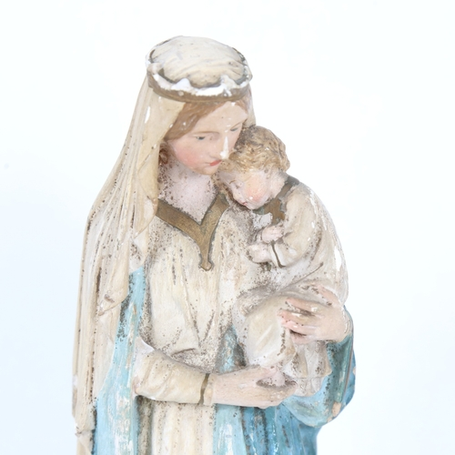 19 - A mid-20th century painted plaster sculpture, depicting Madonna and Child, dated 1935, height 31cm