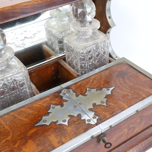 28 - A Vintage chrome-mounted oak tantalus, with mirror-back, folding compartments and drawer, needs new ...