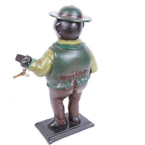 31 - An American painted cast-iron novelty figural clock, modelled as man playing a banjo with moving eye...