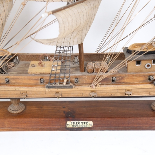 32 - A handmade model frigate warship, with 18lb  guns, on wood stand, overall length 82cm, overall heigh...