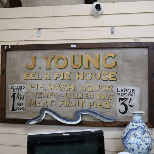 40 - A large handmade shop advertising sign, for J Young Eel and Pie House, 66cm x 130cm