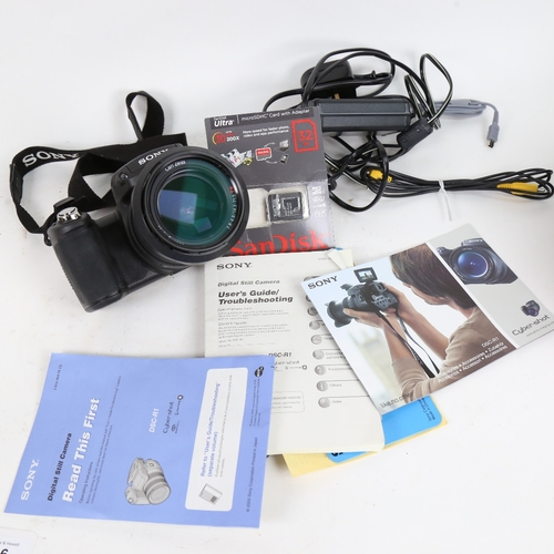 46 - A Sony Cyber-Shot 10.3 megapixel CMOS DSC-R1 digital camera, with cables and booklets