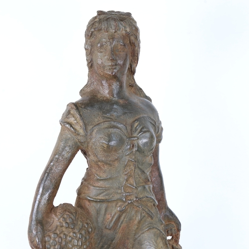 50 - A large and heavy cast-iron figural sculpture, lady carrying grapes, unsigned, height 67cm