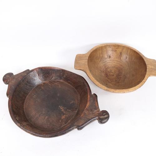 52 - 2 carved hardwood food bowls, largest length 49cm (2)