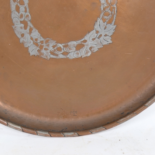 57 - An Arts and Crafts hammered copper tray, by Hugh Wallis, diameter 28cm