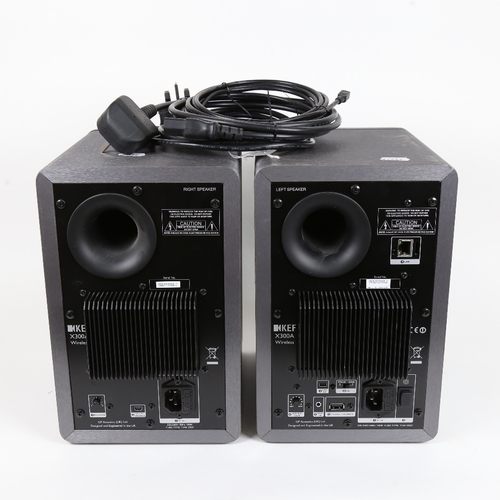6 - KEF - a pair of black X300A wireless bookshelf loud speakers, with cabling