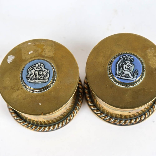 19 - A pair of trench art brass cannon shell case boxes, with inset Wedgwood blue and white Jasperware pl...
