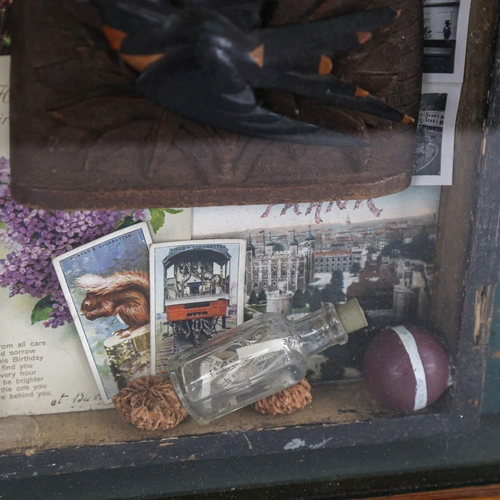 22 - A glazed wall-mounted display case, containing family memorabilia, height 38cm