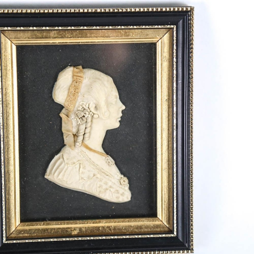 3 - A pair of 19th century relief moulded wax profiles, depicting officer and a lady, both framed, overa...
