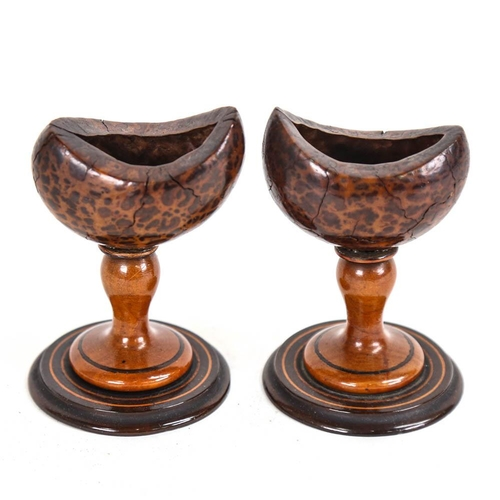 30 - A pair of Antique treen eye baths, on turned pedestals, height 10cm