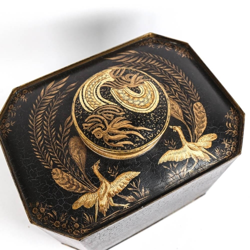 34 - A large modern octagonal tea canister, with black painted and gilded design of tropical birds and fo...