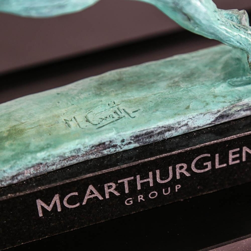 38 - Mark Coreth (British, born 1948), a patinated bronze model of a winged lion, on presentation plinth,...