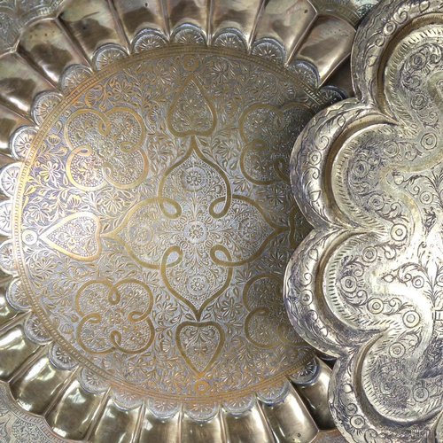 48 - 2 Eastern brass table-tops with engraved decoration, largest 60cm