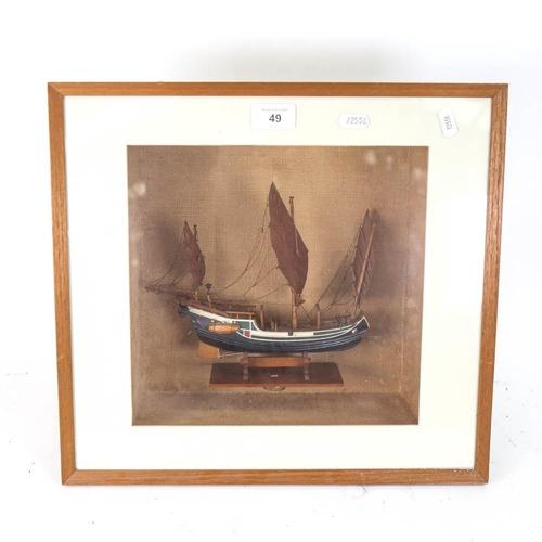 49 - A carved and painted model 3-masted ship, in glazed wall-mounted display case, height 35cm overall