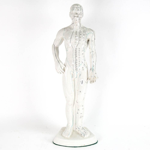 5 - An Oriental doctor's table-top ceramic anatomical model, with numbered annotations, height 51cm