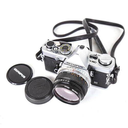 54 - OLYMPUS - a Vintage OM-1n 35mm single lens reflex camera, with Olympus 50mm 1:1.8 lens and Hunter 49...