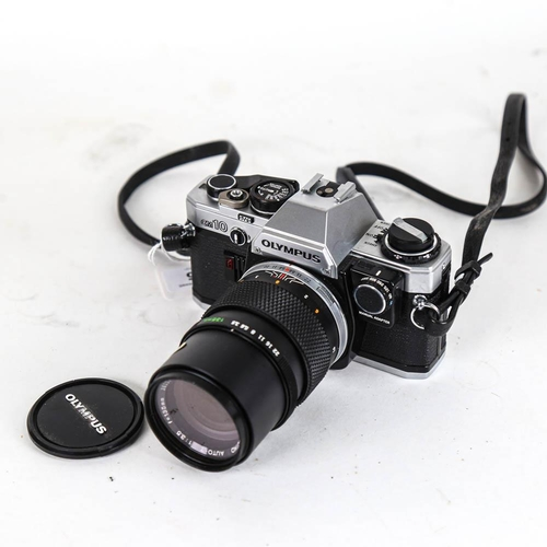 55 - OLYMPUS - a Vintage OM10 35mm single lens reflex camera, with Olympus 135mm 1:3.5 lens and Skylight ...